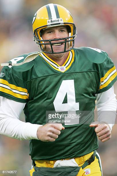 Brett Favre of the Green Bay Packers is all smiles after completing a touchdown pass against the Minnesota Vikings during a game at Lambeau Field on...