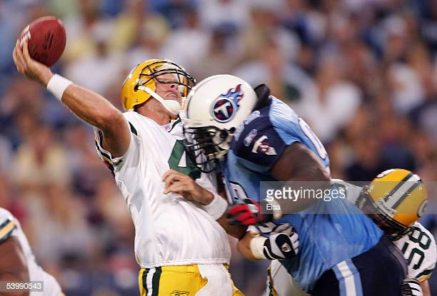 Brett Favre of the Green Bay Packers is hit by Albert Haynesworth of the Tennessee Titans during the first half on September 1 2005 at The Coliseum...