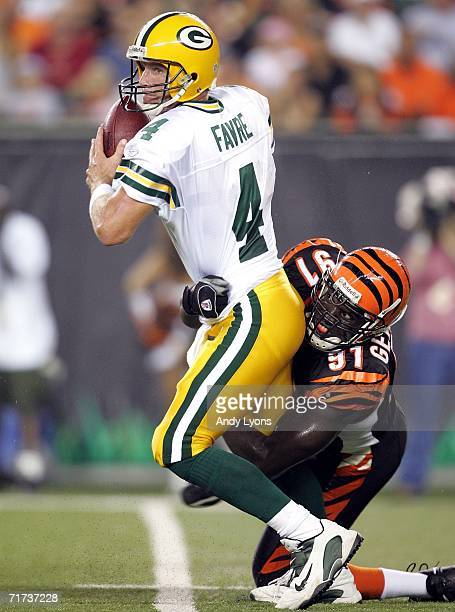Brett Favre of the Green Bay Packers is sacked by Robert Geathers of the Cincinnati Bengals during the NFL pre-season game at Paul Brown Stadium on...