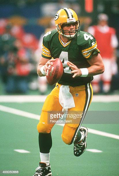 Brett Favre of the Green Bay Packers looks to pass against the New England Patriots during Super Bowl XXXI January 26 1997 at the Louisiana Superdome...