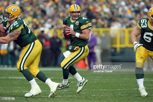 Brett Favre of the Green Bay Packers moves back with the ball during the game against the Minnesota Vikings give chase on November 11 2007 at Lambeau...