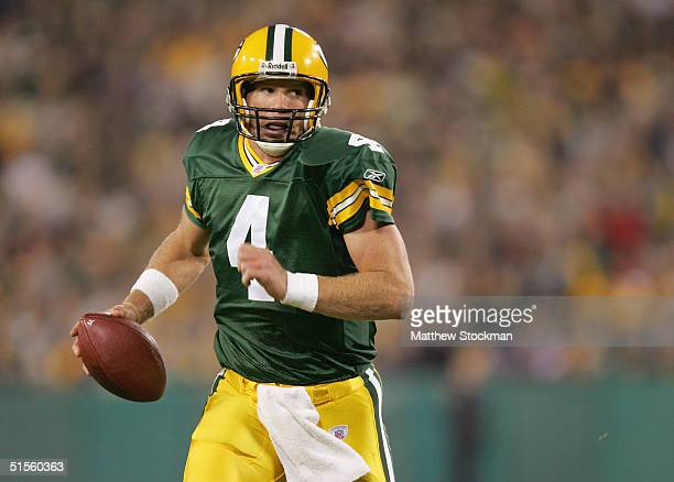 Brett Favre of the Green Bay Packers runs against the Tennessee Titans during the Monday Night Football game on October 11 2004 at Lambeau Field in...