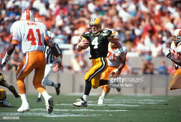 Brett Favre of the Green Bay Packers scrambles with the ball against the Tampa Bay Buccaneers during an NFL football game October 24, 1993 at Tampa...