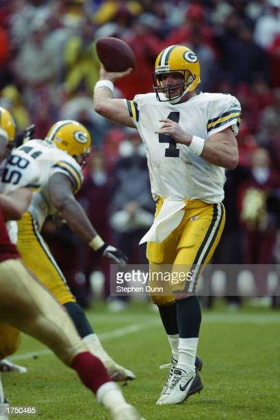Brett Favre of the Green Bay Packers throws a pass during the game against the San Francisco 49ers on December 15 2002 at 3Com Park in San Francisco...