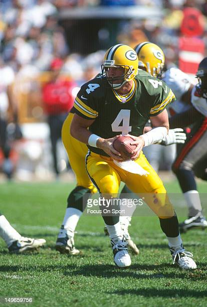 Brett Favre of the Green Bay Packers turns to hand the ball off against the Tampa Bay Buccaneers during an NFL football game at Lambeau Field October...