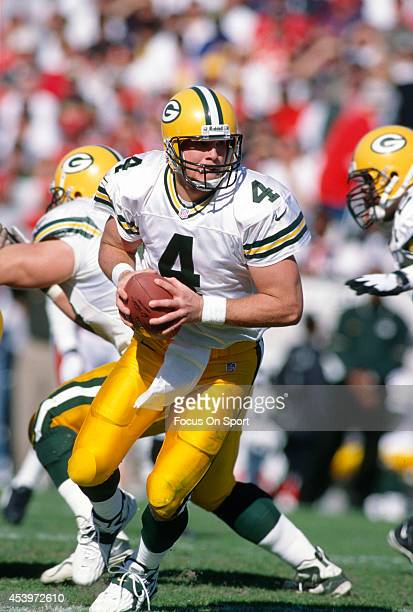 Brett Favre of the Green Bay Packers turns to hand the ball off to a running back against the Tampa Bay Buccaneers during an NFL football game at...