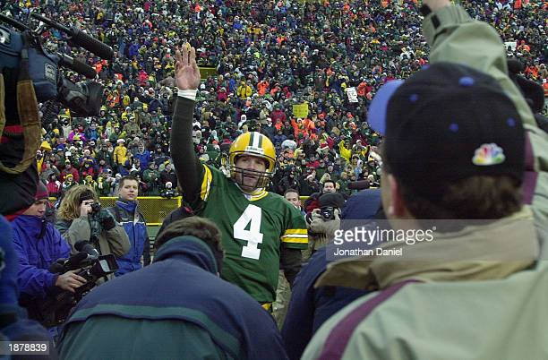 Brett Favre of the Green Bay Packers waves to the crowd against the Buffalo Bills during the game at Lambeau Field on December 22 2002 in Green Bay...