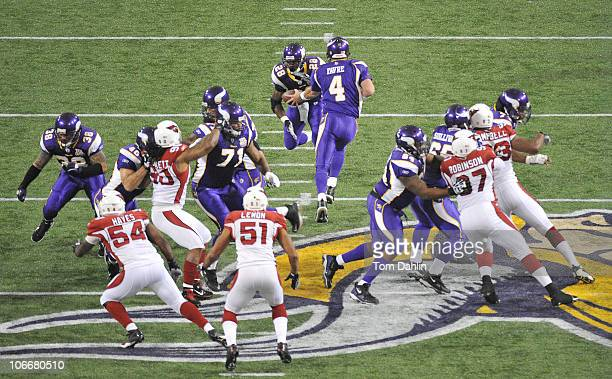 Brett Favre of the Minnesota Vikings hands off the ball to teammate Adrian Peterson during an NFL game against the Arizona Cardinals at Mall of...