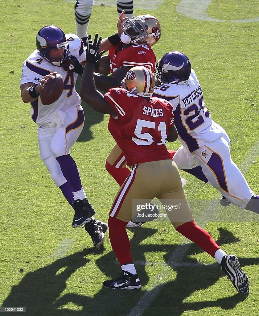 Brett Favre #4 of the Minnesota Vikings is pressured by Patrick Willis #52 and Takeo Spikes #51 of the San Francisco 49ers during an NFL pre-season game at Candlestick Park on August 22, 2010 in San Francisco, California.