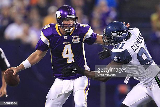 Brett Favre of the Minnesota Vikings is sacked by Chris Clemons of the Seattle Seahawks during a preseason NFL game at Mall of America Field at the...
