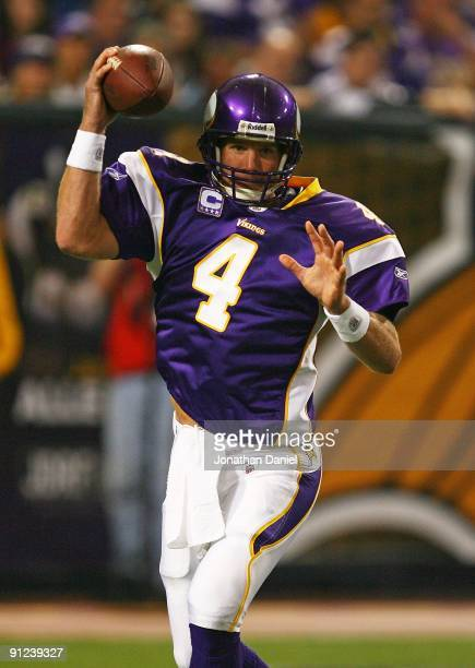 Brett Favre of the Minnesota Vikings pump-fakes a pass as he looks for a receiver against the San Francisco 49ers at the Hubert H. Humphrey Metrodome...
