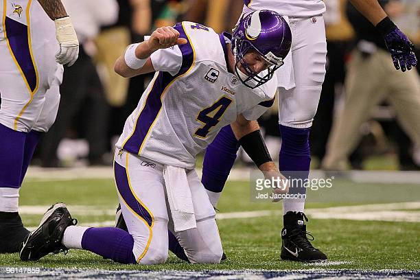 Brett Favre of the Minnesota Vikings reacts after taking a hard hit in the second half against the New Orleans Saints during the NFC Championship...