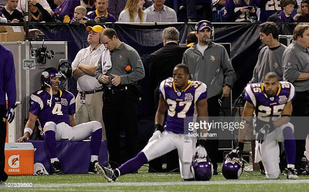 Brett Favre of the Minnesota Vikings sits on the sideline against the Buffalo Bills defense at the Mall of America Field at the Hubert H Humphrey...