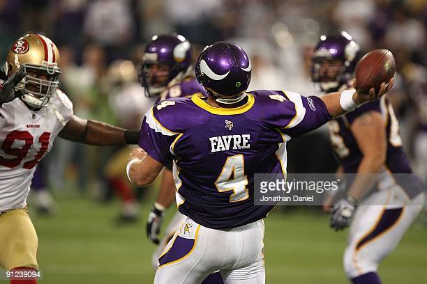 Brett Favre of the Minnesota Vikings throws a pass as Ray McDonald of the San Francisco 49ers rushes at the Hubert H. Humphrey Metrodome on September...