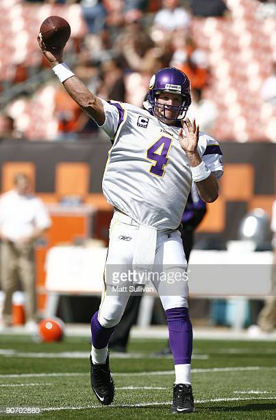 Brett Favre of the Minnesota Vikings throws a pass during pre-game warmups prior to their game against the Cleveland Browns at Cleveland Browns...