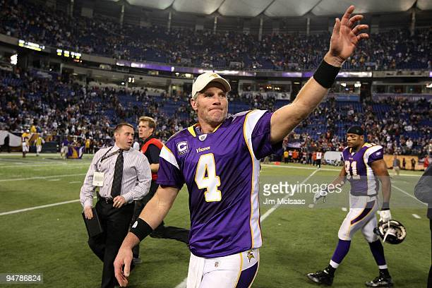 Brett Favre of the Minnesota Vikings waves to the crowd after defeating the Cincinnati Bengals on December 13 2009 at Hubert H Humphrey Metrodome in...