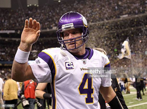 Brett Favre of the Minnesota Vikingswalks off of the field after losing against the New Orleans Saints in the NFC Championship Game at the Louisiana...