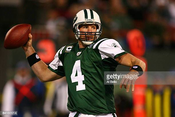 Brett Favre of The New York Jets looks to pass against The Miami Dolphins during their game on December 28 2008 at Giants Stadium in East Rutherford...