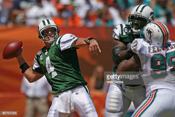 Brett Favre of the New York Jets throws a 56yard touchdown pass to Jerricho Cotchery in the first quarter against the Miami Dolphins at Dolphin...