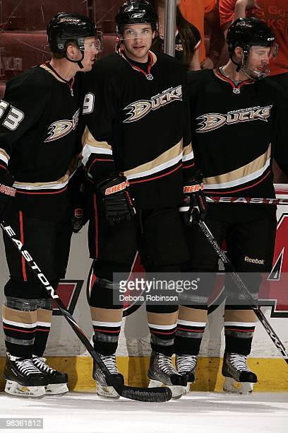 Brett Festerling Bobby Ryan and Aaron Ward of the Anaheim Ducks talk on the ice during pre game warm ups prior to the game against the Vancouver...
