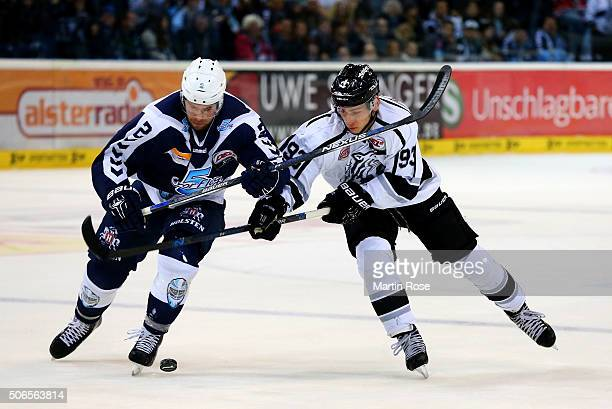 Brett Festerling of Hamburg Freezers battles for the puck with David Steckel of Thomas Sabo Ice Tigers during the DEL game between Hamburg Freezers...