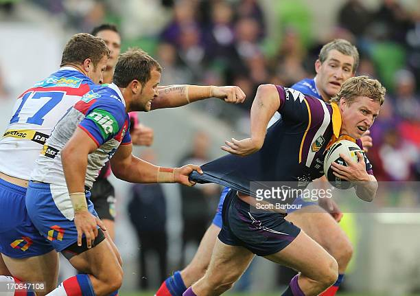 Brett Finch of the Storm runs with the ball during the round 14 NRL match between the Melbourne Storm and the Newcastle Knights at AAMI Park on June...