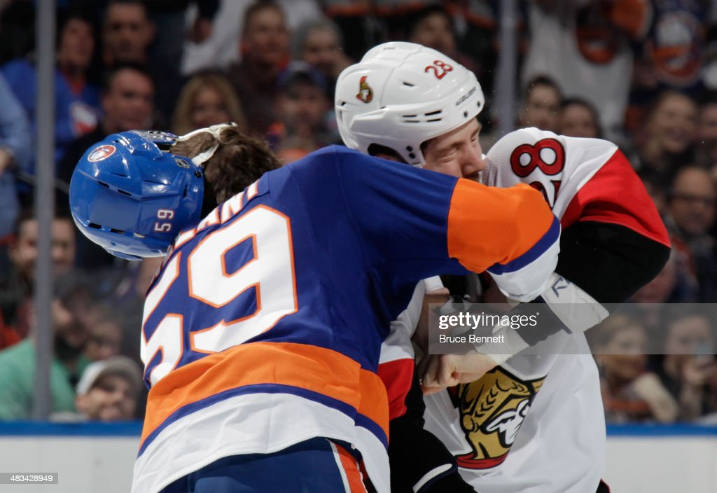 Brett Gallant #59 of the New York Islanders fights with Matt Kassian #28 of the Ottawa Senators in the first period at the Nassau Veterans Memorial Coliseum on April 8, 2014 in Uniondale, New York.