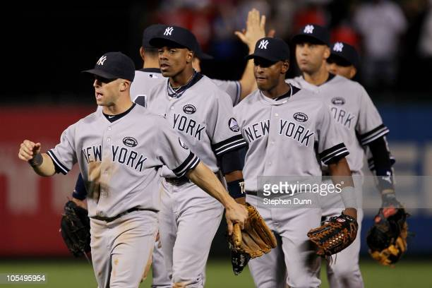 Brett Gardner and Curtis Granderson and the New York Yankees celebrate after defeating the Texas Rangers by a score of 65 to win Game One of the ALCS...