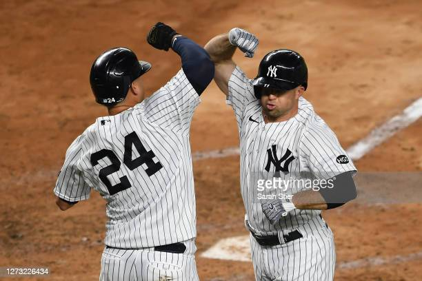 Brett Gardner celebrates with Gary Sanchez of the New York Yankees after Gardner hit a tworun home run during the fourth inning against the Toronto...