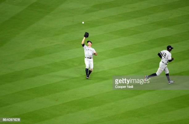 Brett Gardner of the New York Yankees catches a fly ball during Game 6 of the American League Championship Series against the Houston Astros at...