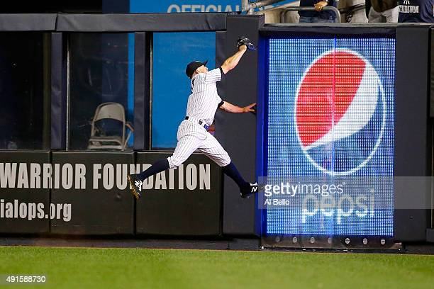 Brett Gardner of the New York Yankees catches fly ball to center field hits a by Evan Gattis of the Houston Astros in the second inning during the...