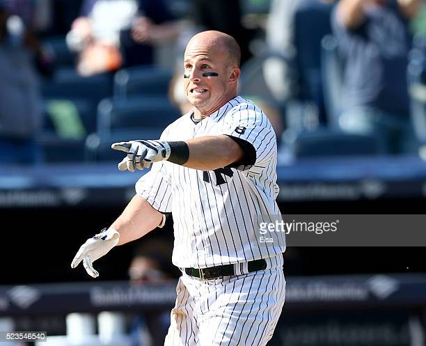 Brett Gardner of the New York Yankees celebrates his walkoff home run to win the game against the Tampa Bay Rays at Yankee Stadium on April 23 2016...