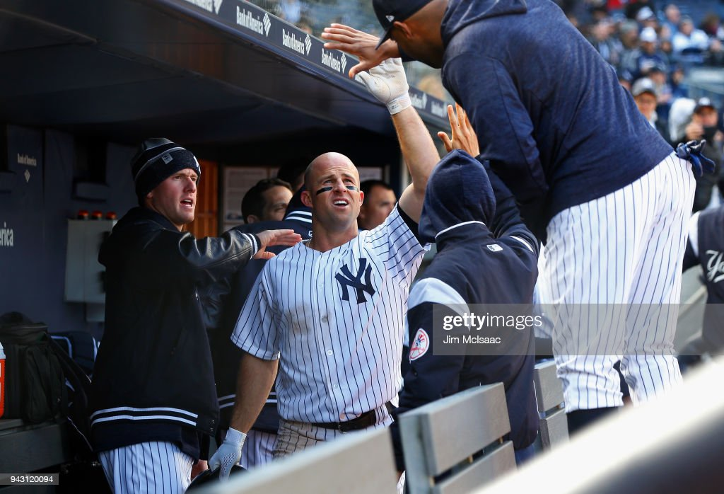 Brett Gardner #11 of the New York Yankees celebrates with his teammates in the dugout after scoring a run in the seventh inning against the Baltimore Orioles at Yankee Stadium on April 7, 2018 in the Bronx borough of New York City.