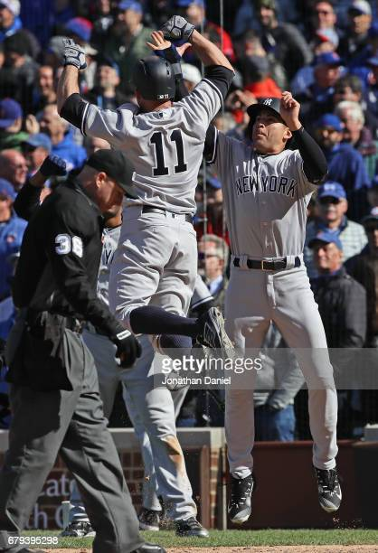 Brett Gardner of the New York Yankees celebrates with Jacoby Ellsbury after hitting a three run home ini the 9th inning against the Chicago Cubs at...