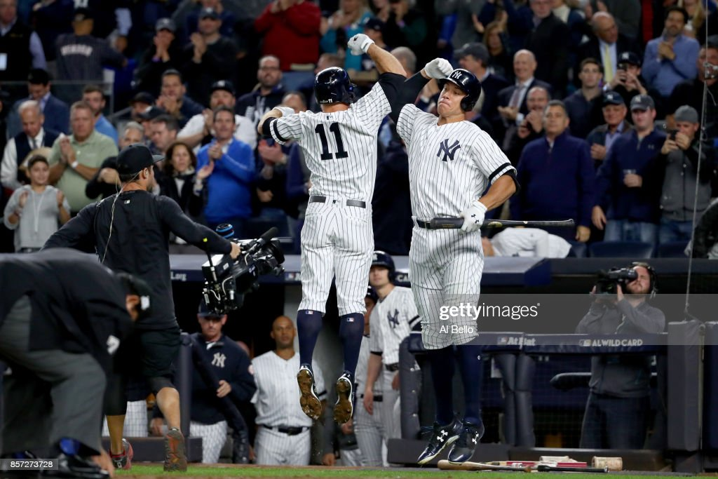 Brett Gardner #11 of the New York Yankees celebrates with teammate Aaron Judge #99 after hitting a home run against Ervin Santana #54 of the Minnesota Twins during the second inning in the American League Wild Card Game at Yankee Stadium on October 3, 2017 in the Bronx borough of New York City.