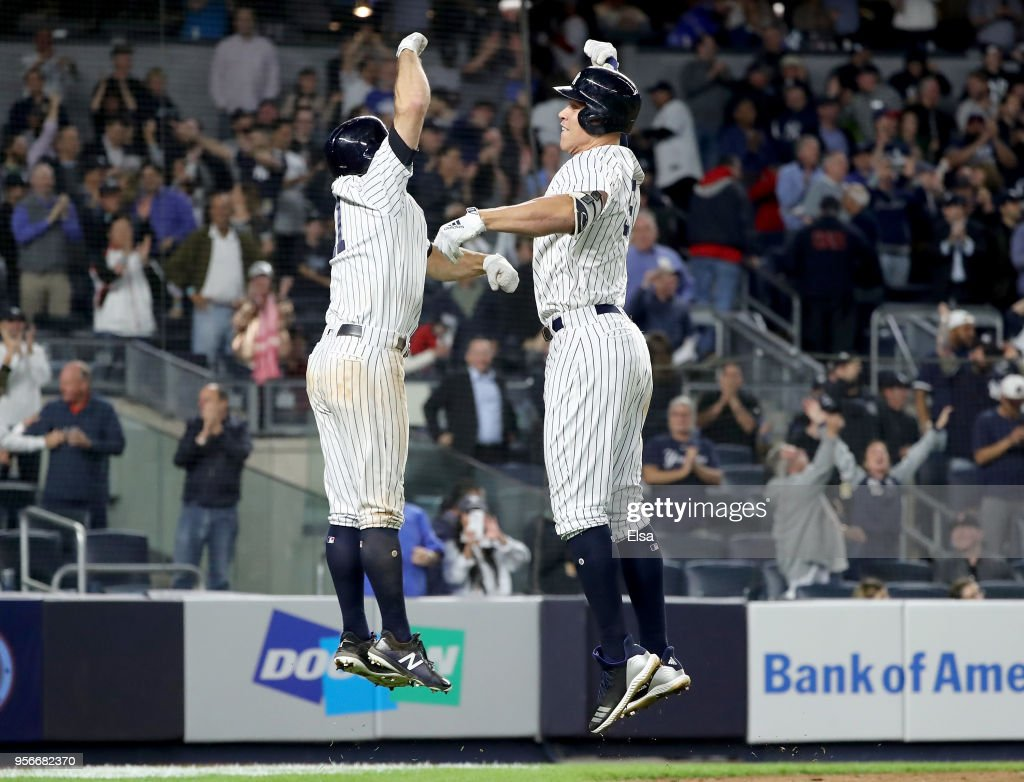 Brett Gardner #11 of the New York Yankees celebrates with teammate Aaron Judge #99 after Judge hit a home run scoring them both in the eighth inning against the Boston Red Sox at Yankee Stadium on May 9, 2018 in the Bronx borough of New York City.