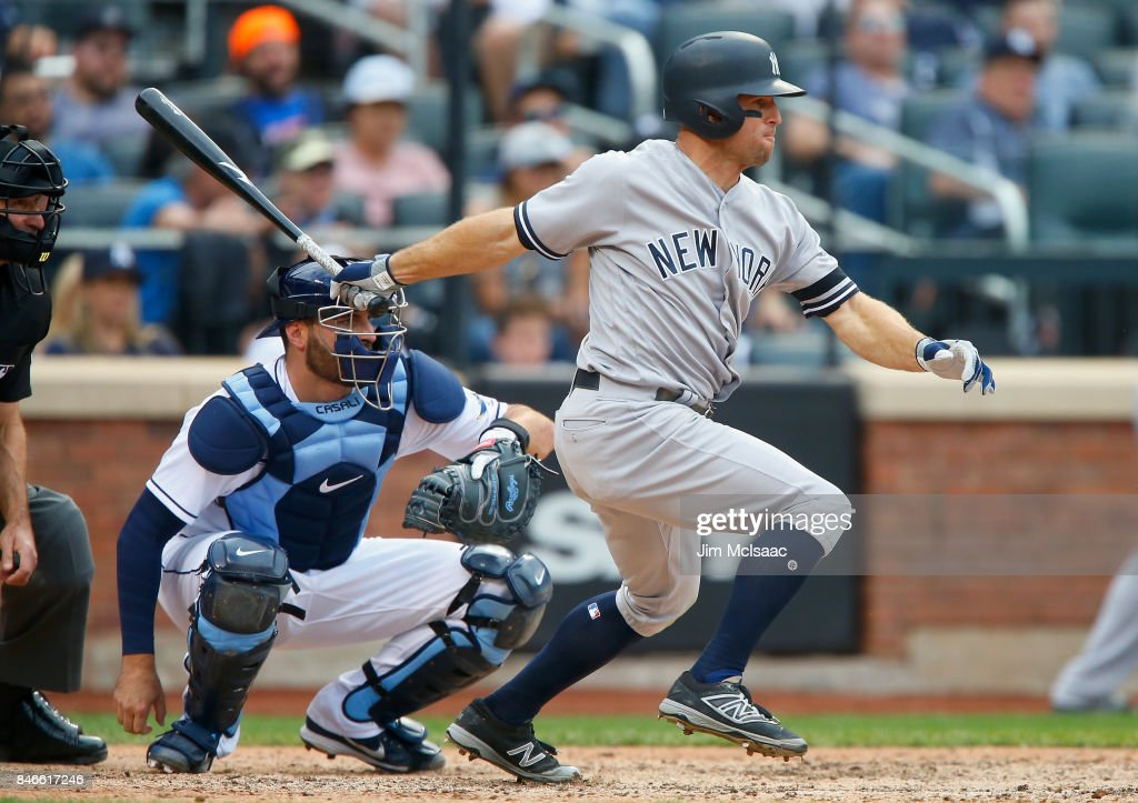 Brett Gardner #11 of the New York Yankees follows through on a single in the ninth inning against the Tampa Bay Rays at Citi Field on September 13, 2017 in the Flushing neighborhood of the Queens borough of New York City. The two teams were scheduled to play in St. Petersburg, Florida but due to the weather emergency caused by Hurricane Irma, the game was moved to New York, but with Tampa Bay remaining the 'home' team.
