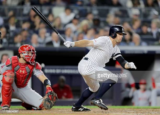 Brett Gardner of the New York Yankees hits a 2 RBI double in the sixth inning as Kevan Smith of the Los Angeles Angels defends at Yankee Stadium on...