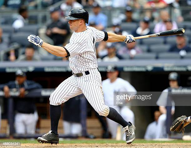 Brett Gardner of the New York Yankees hits a 2 RBI single in the eighth inning against the Tampa Bay Rays on May 3 2014 at Yankee Stadium in the...