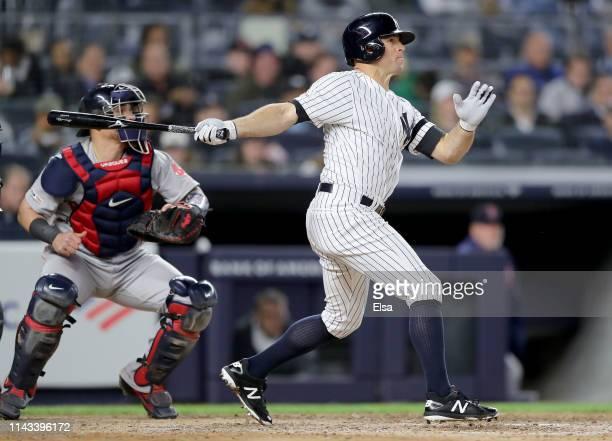 Brett Gardner of the New York Yankees hits a grand slam as Christian Vazquez of the Boston Red Sox defends in the seventh inning at Yankee Stadium on...