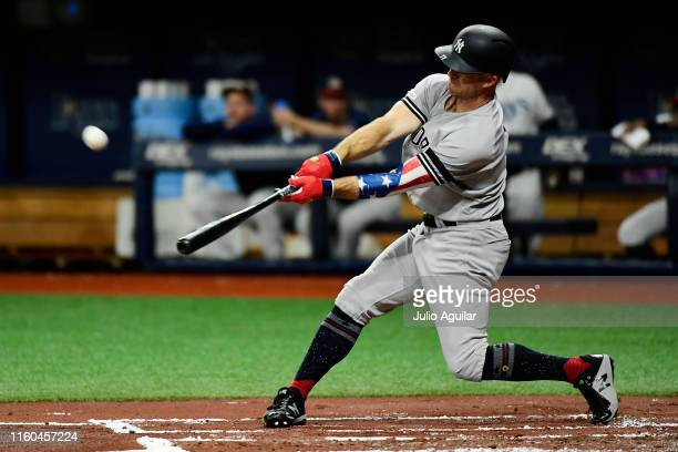 Brett Gardner of the New York Yankees hits a homer off of Blake Snell of the Tampa Bay Rays in the first inning of a baseball game at Tropicana Field...