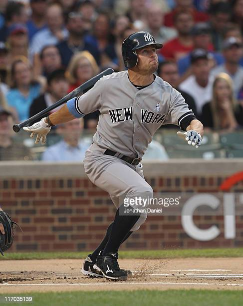 Brett Gardner of the New York Yankees hits a leadoff home run in the 1st inning against the Chicago Cubs at Wrigley Field on June 19 2011 in Chicago...