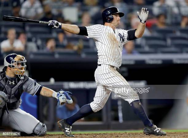 Brett Gardner of the New York Yankees hits a solo home run in the 11th inning as Wilson Ramos of the Tampa Bay Rays defends on July 27 2017 at Yankee...