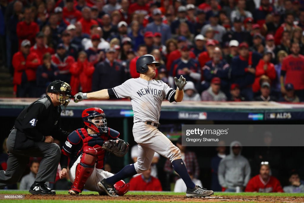Brett Gardner #11 of the New York Yankees hits a two RBI single in the ninth inning against the Cleveland Indians in Game Five of the American League Divisional Series at Progressive Field on October 11, 2017 in Cleveland, Ohio.