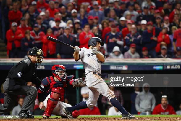Brett Gardner of the New York Yankees hits a two RBI single in the ninth inning against the Cleveland Indians in Game Five of the American League...