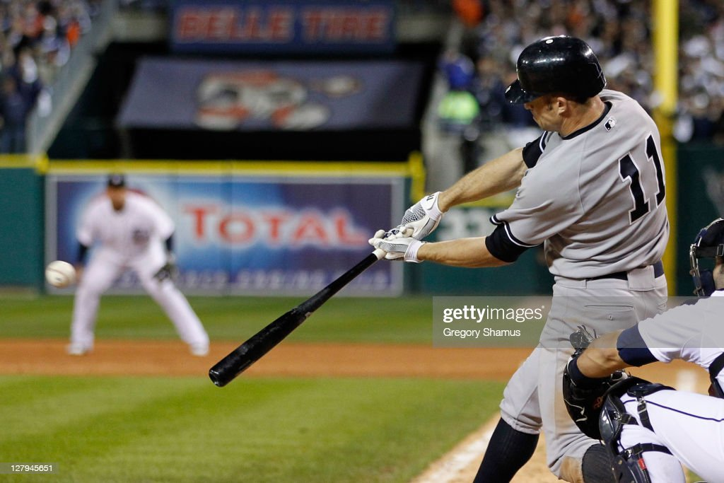Brett Gardner #11 of the New York Yankees hits a two-run RBI double in the seventh inning of Game Three of the American League Division Series against the Detroit Tigers at Comerica Park on October 3, 2011 in Detroit, Michigan.