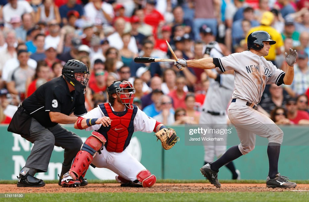 Brett Gardner #11 of the New York Yankees hits an RBI single in the fifth inning against the Boston Red Sox during the game on July 20, 2013 at Fenway Park in Boston, Massachusetts.