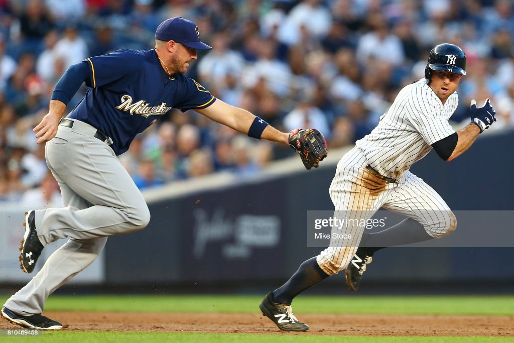 Brett Gardner #11 of the New York Yankees is caught in a run down and tagged out by Travis Shaw #21 of the Milwaukee Brewers at Yankee Stadium on July 7, 2017 in the Bronx borough of New York City.