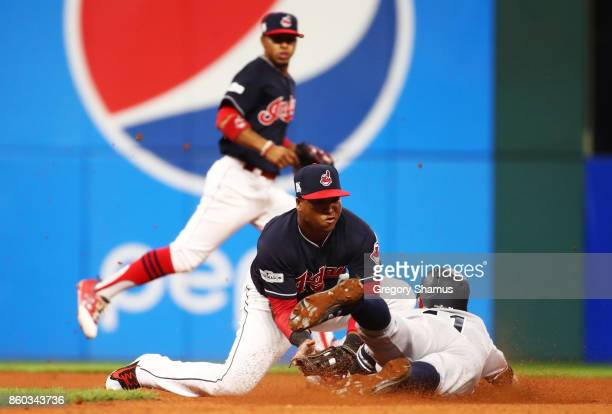 Brett Gardner of the New York Yankees is caught stealing second by Jose Ramirez of the Cleveland Indians in the seventh inning in Game Five of the...