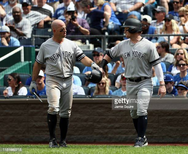 Brett Gardner of the New York Yankees is congratulated by Clint Frazier after scoring during the 7th inning of the game against the Kansas City...